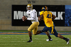 BERKELEY, CA - OCTOBER 06: Quarterback Brett Hundley #17 of the UCLA Bruins is pressured by defensive lineman Todd Barr #41 of the California Golden Bears during the first quarter at California Memorial Stadium on October 6, 2012 in Berkeley, California. The California Golden Bears defeated the UCLA Bruins 43-17. (Photo by Jason O. Watson/Getty Images) *** Local Caption *** Brett Hundley; Todd Barr