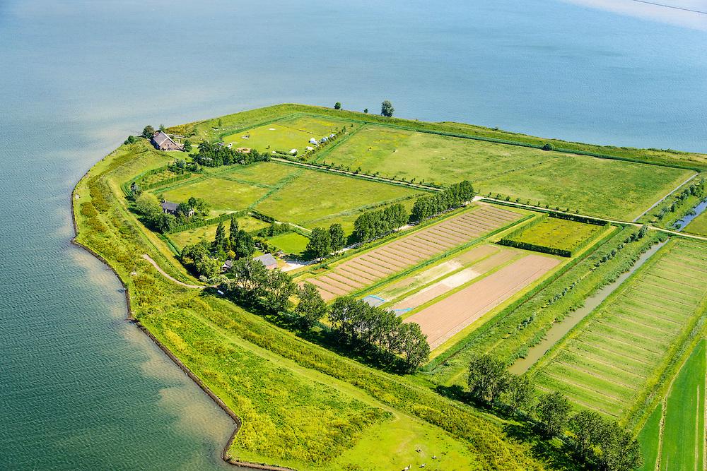 """Nederland, Zuid-Holland, Tiengemeten 10-06-2015; oostelijk deel van het eiland Tiengemeten met zorgboerderij en camping.<br /> Oorspronkelijk gebruikt voor de akkerbouw maar inmiddels 'teruggegeven aan de natuur', de dijken zijn deels doorgestoken, de laatste boer is in 2006 vertrokken. De 'nieuwe natuur' vormt onderdeel van de Ecologische Hoofdstructuur. <br /> The island Tiengemeten in the Haringvliet, was originally used for agriculture but has now """"been given back to nature"""". Large parts have been flooded and the isle is part of the National Ecological Network. The last farmer left in 2006. Current use, among other, care farms and camping.<br /> luchtfoto (toeslag op standard tarieven);<br /> aerial photo (additional fee required);<br /> copyright foto/photo Siebe Swart"""