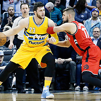 18 November 2016: Denver Nuggets center Jusuf Nurkic (23) posts up Toronto Raptors center Jonas Valanciunas (17) during the Toronto Raptors 113-111 OT victory over the Denver Nuggets, at the Pepsi Center, Denver, Colorado, USA.