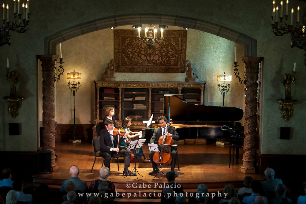 The Horszowski Trio, consisting of Jesse Mills, Raman Ramakrishnan, and Rieko Aizawa, perform in the Music Room of the Rosen House at Caramoor in Katonah New York on April 19, 2015. <br /> (photo by Gabe Palacio)