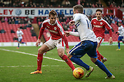 James Bree (Barnsley) marks Tom Pope (Bury) during the Sky Bet League 1 match between Barnsley and Bury at Oakwell, Barnsley, England on 7 February 2016. Photo by Mark Doherty.