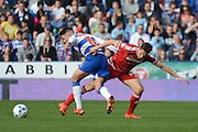 Middlesbrough midfielder Stewart Downing tackles Reading midfielder Oliver Norwood during the Sky Bet Championship match between Reading and Middlesbrough at the Madejski Stadium, Reading, England on 3 October 2015. Photo by Alan Franklin.