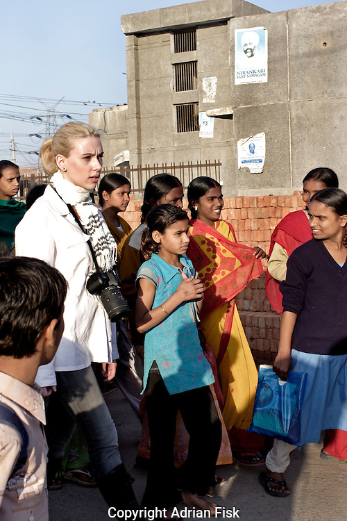 Scarlett takes a walk around a slum rehabilitation colony on the outskirts of Delhi