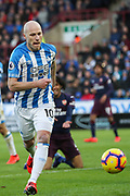 Huddersfield Town midfielder Aaron Mooy (10) in action  during the Premier League match between Huddersfield Town and Arsenal at the John Smiths Stadium, Huddersfield, England on 9 February 2019.