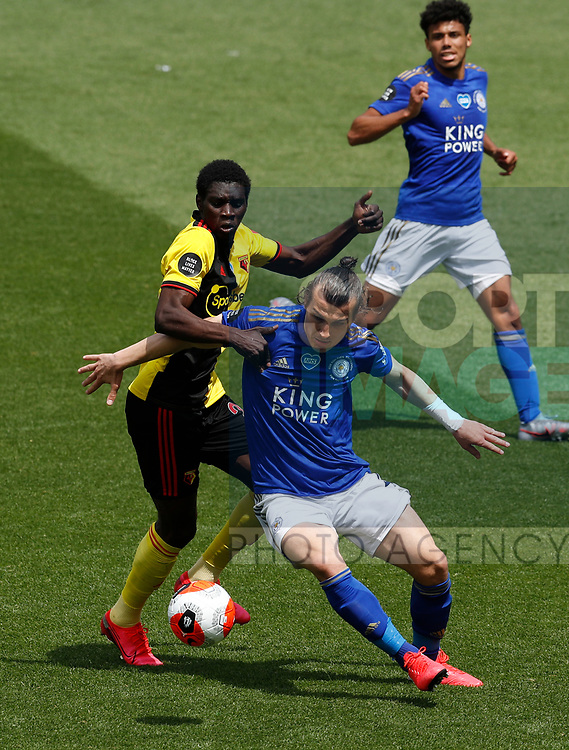Caglar Soyuncu of Leicester City tackles Ismaila Sarr of Watford during the Premier League match at Vicarage Road, Watford. Picture date: 20th June 2020. Picture credit should read: Darren Staples/Sportimage