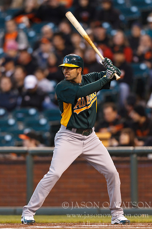 March 28, 2011; San Francisco, CA, USA;  Oakland Athletics center fielder David DeJesus (12) at bat against the San Francisco Giants during the first inning at AT&T Park.  San Francisco defeated Oakland 4-3.