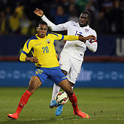 Jozy Altidore, USA, challenges Luis Canga, Ecuador,   during the USA Vs Ecuador International match at Rentschler Field, Hartford, Connecticut. USA. 10th October 2014. Photo Tim Clayton