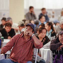 Local residents and fisherman listen to a presentation for projects to be voted on during a LA Safe Asian community meeting in Gretna, Louisiana, U.S., on Wednesday, December 20, 2017. Louisiana is preparing recommendations through projects with LA Safe for emptying out coastal areas that are unprotected by levees and will be impacted by sea level rise in the coming years. Photographer: Derick E. Hingle/Bloomberg