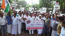 July 19, 2017 - Kolkata, West Bengal, India - The active workers of garment industries at metiaburuz during a protest march against Central Government of India for implementation of 'Goods and service tax' or 'GST' on garments in India on July 19, 2017 in Kolkata in India..The active workers of garment industries at metiaburuz during a protest march against Central Government of India for implementation of 'Goods and service tax' or 'GST' on garments in India on July 19, 2017 in Kolkata in India. (Credit Image: © Sanjay Purkait/Pacific Press via ZUMA Wire)
