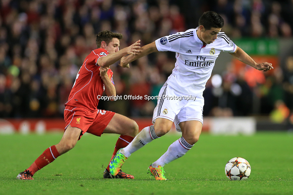 22nd October 2014 - UEFA Champions League - Group B - Liverpool v Real Madrid - James Rodriguez of Real battles with Joe Allen of Liverpool - Photo: Simon Stacpoole / Offside.