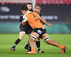 Ospreys' Dimitri Arhip tackled by Cheetahs' Justin Basson<br /> <br /> Photographer Mike Jones/Replay Images<br /> <br /> Guinness PRO14 Round Round 16 - Ospreys v Cheetahs - Saturday 24th February 2018 - Liberty Stadium - Swansea<br /> <br /> World Copyright © Replay Images . All rights reserved. info@replayimages.co.uk - http://replayimages.co.uk