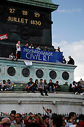 Civil Disobedience, May Day March, Paris, 1 May 2009. Protestors on the Colonne de Juillet being rather literal and obvious.