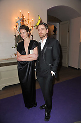 NATALIA VODIANOVA and SCOTT DOUGLAS at The Surrealist Ball in aid of the NSPCC in association with Harpers Bazaar magazine held at the Banqueting House, Whitehall, London on 17th March 2011.