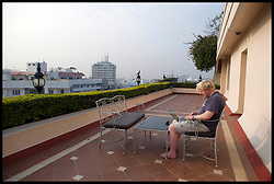 London Mayor Boris Johnson writting his speech on his hotel balcony in Hyderabad, on the forth day of a six-day tour of India, where he will be trying to persuade Indian businesses to invest in London, Wednesday November 28, 2012. Photo by Andrew Parsons / i-Images