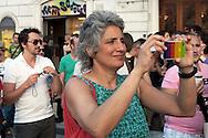 Roma 23 Giugno 2012.GayPride 2012.La Sfilata del Gay pride, la giornatà dell' orgoglio omossessuale per le vie della città. Anna Paola Concia fotografa con Iphone