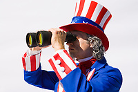 Uncle Sam looking through large binoculars.