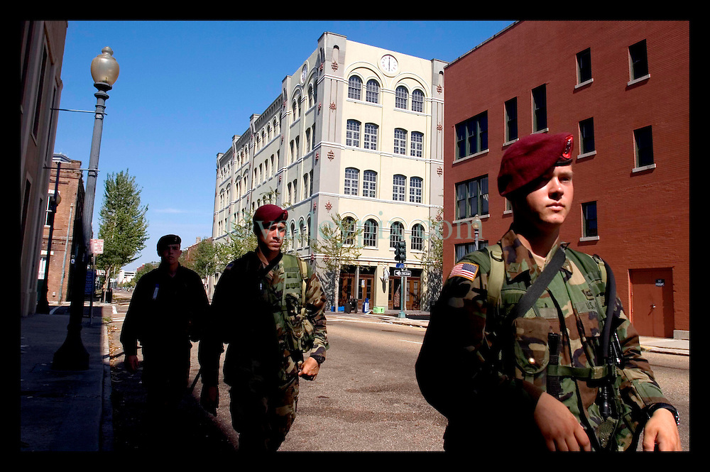 8th Sept, 2005. Hurricane Katrina aftermath. New Orleans. Members of the 82nd Airborn Regiment patrol the streets of the Central Business District to prevent any furthur looting and to secure the area.