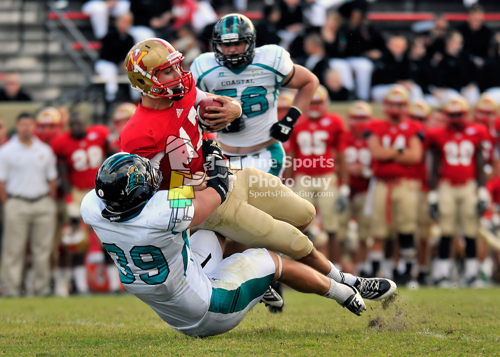 NCAA FCS: VMI football just avoids shutout in 34-7 loss to Coastal Carolina - VMI backup quarterback A.J. Augustine is brought down by Coastal Carolina's Colton Blackburn after scrambling for a first down.  Augustine led the Keydets to a touchdown in the waning minutes of Saturday's 34-7 loss to the Chanticleers, avoiding the shutout.