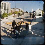 Protesters in front of the Greek parliament. <br /> <br /> Following the murder of a 15 year old boy, Alexandros Grigoropoulos, by a policeman on 6 December 2008 widespread riots, protests and unrest followed lasting for several weeks and spreading beyond the capital and even overseas<br /> <br /> When I walked in the streets of my town the day after the riots I instantly forgot the image I had about Athens, that of a bustling, peaceful, energetic metropolis and in my mind came the old photographs from WWII, the civil war and the students uprising against the dictatorship. <br /> <br /> Thus I decided not to turn my digital camera straight to the destroyed buildings but to photograph through an old camera that worked as a filter, a barrier between me and the city.