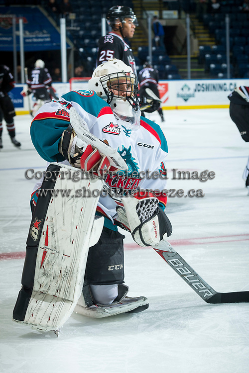 KELOWNA, CANADA - NOVEMBER 11: Ethan Hunt #30 of the Kelowna Rockets stretches on the ice during warm up against the Red Deer Rebels on November 11, 2017 at Prospera Place in Kelowna, British Columbia, Canada.  (Photo by Marissa Baecker/Shoot the Breeze)  *** Local Caption ***