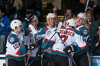 KELOWNA, CANADA - FEBRUARY 10: Nick Merkley #10, Kole Lind #16, Carsen Twarynski #18, Nolan Foote #29 and Lucas Johansen #7 of the Kelowna Rockets celebrate a goal against the Vancouver Giants on February 10, 2017 at Prospera Place in Kelowna, British Columbia, Canada.  (Photo by Marissa Baecker/Shoot the Breeze)  *** Local Caption ***
