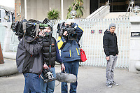 Television camera crew film Occupy Dame Street protesters as they regroup at the Central Bank in Dublin Ireland after their encampment was dismantled by gardaí on 8th March 2012