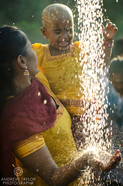A mother and daughter wash after participating in Thaipusam festival, Batu Caves, Kuala Lumpur, Malaysia