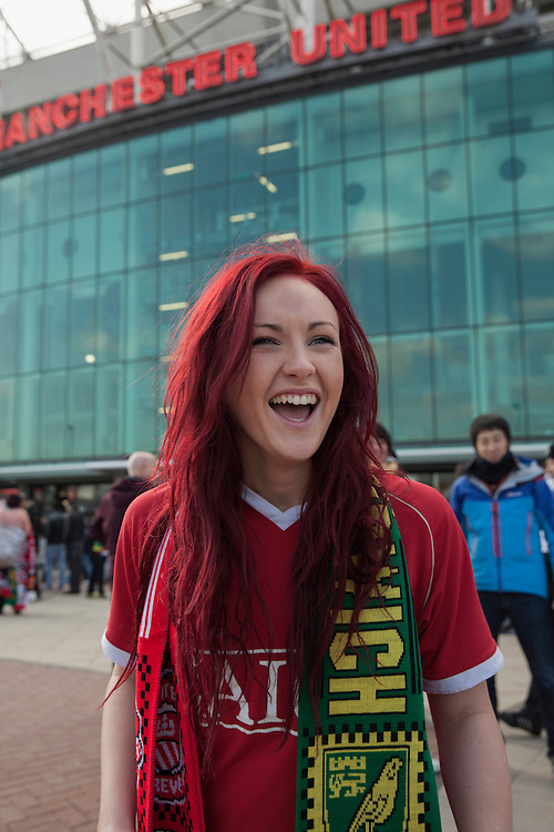Manchester United fan  outside Old Trafford stadium on a match day.