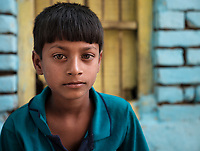 Varanasi, INDIA - CIRCA NOVEMBER 2018: Portrait of kid from a fishing village close to Varanasi. Varanasi is the spiritual capital of India, the holiest of the seven sacred cities and with that many rituals and offerings are performed daily by priests and hindus.