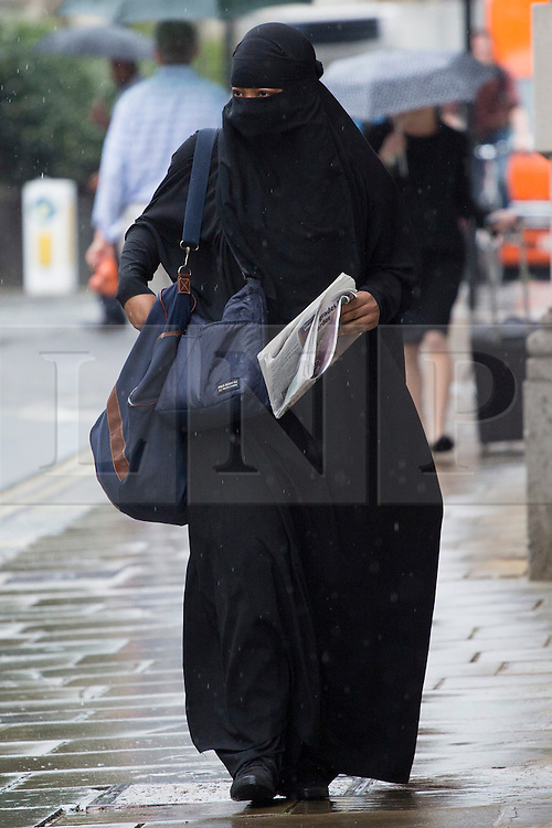 © licensed to London News Pictures. London, UK 16/08/2013. Rebekah Dawson arriving to The Old Bailey Court in London on Friday, 16 August 2013. 21-year-old woman has been charged with terror offences over video clips about the murder of soldier Lee Rigby. Rebekah Dawson, of Hackney, east London, is accused of dissemination of terrorist publications and encouragement of terrorism. Photo credit: Tolga Akmen/LNP