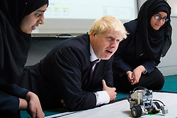 Camden City Learning Centre, London, June 15th 2015. London Mayor Boris Johnson joins future entrepreneurs at Camden City Learning Centre to launch London Technology Week and to launch a dedicated online hub for the Capital's thriving technology industry. PICTURED: Mayor Boris Johnson is fascinated by the robots programmed by students.