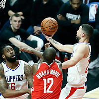 28 February 2018: LA Clippers guard Austin Rivers (25) goes for the layup against Houston Rockets forward Luc Mbah a Moute (12) during the Houston Rockets 105-92 victory over the LA Clippers, at the Staples Center, Los Angeles, California, USA.