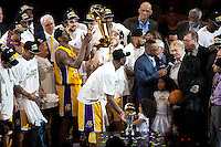 17 June 2010:  Sasha Vujacic of the Los Angeles Lakers holds up the Larry O'Brien trophy and passes it to Ron Artest as they celebrate with their team after the Lakers defeat the Boston Celtics 83-79 and win the NBA championship in Game 7 of the NBA Finals at the STAPLES Center in Los Angeles, CA.