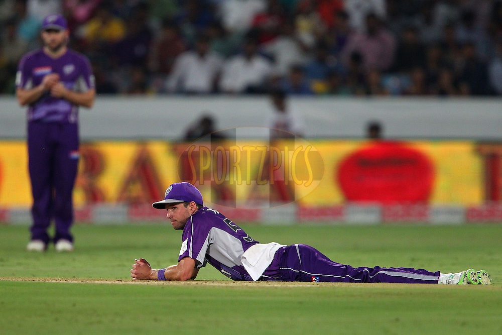 Ben LAUGHLIN of the Hobart Hurricanes looks on after an attempted run out during the first semi final match of the Oppo Champions League Twenty20 between the Kolkata Knight Riders and the Hobart Hurricanes held at the Rajiv Gandhi Cricket Stadium, Hyderabad, India on the 2nd October 2014<br /> <br /> Photo by:  Ron Gaunt / Sportzpics/ CLT20<br /> <br /> <br /> Image use is subject to the terms and conditions as laid out by the BCCI/ CLT20.  The terms and conditions can be downloaded here:<br /> <br /> http://sportzpics.photoshelter.com/gallery/CLT20-Image-Terms-and-Conditions-2014/G0000IfNJn535VPU/C0000QhhKadWcjYs