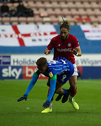 Ashley Williams of Bristol City (R) and Jamal Lowe of Wigan Athletic in action - Mandatory by-line: Jack Phillips/JMP - 11/01/2020 - FOOTBALL - DW Stadium - Wigan, England - Wigan Athletic v Bristol City - English Football League Championship