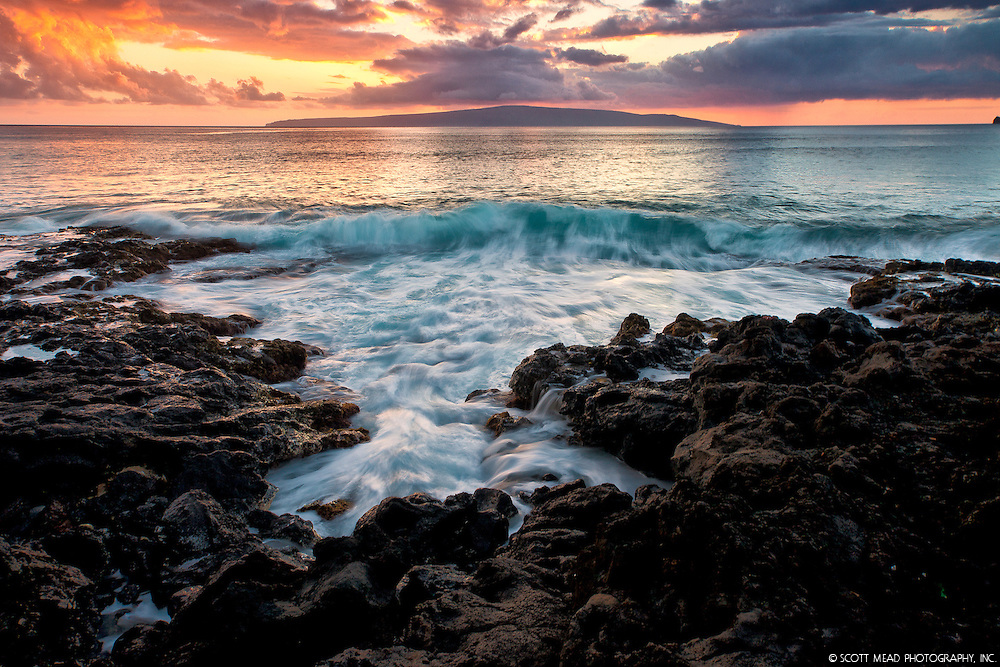 crashing wave at sunset behind Kahoolawe Island, Maui Country, Hawaii