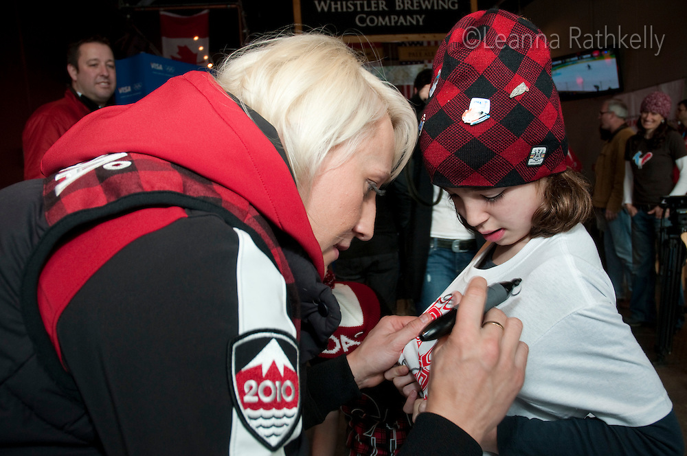 Gold medalist Kaillie Humphries signs autographs at the Whistler Brewing Company after winning the women's bobsleigh with teammate Heather Moyse during the 2010 Olympic Winter Games in Whistler, BC, Canada.