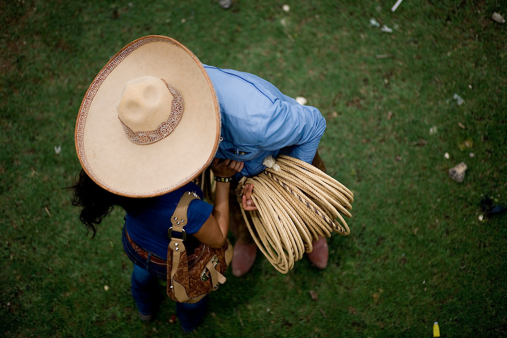 A charro gets a kiss from his sweetheart before the start of a charreada at Rancho Alegre in San Antonio.