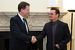© Licensed to London News Pictures. 11/10/2012. LONDON, UK. U2 singer Bono (R) shakes hands with the British Deputy Prime Minister Nick Clegg as the pair meet to discuss international development issues in Whitehall, London, today (11/10/12). Photo credit: Matt Cetti-Roberts/LNP