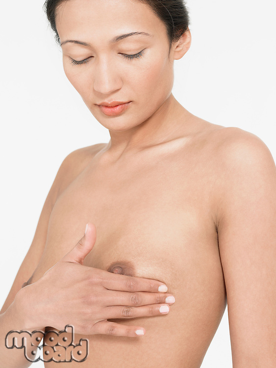 Young Woman Examining own left Breast