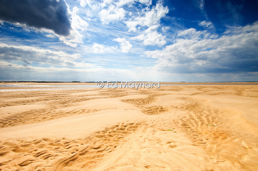 Vast empty beach of Burnham Overy Staithe, North Norfolk Coast, England, UK.