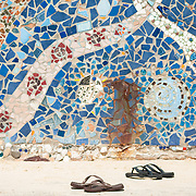 Thongs left in front of wall at Bondi Beach, Sydney.