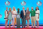 Aug 3, 2019; Canton, OH, USA; Members of the Bowlen family pose with the bust of the late Pat Bowlen during the Pro Football Hall of Fame Enshrinement at Tom Benson Hall of Fame Stadium. (Robin Alam/Image of Sport)