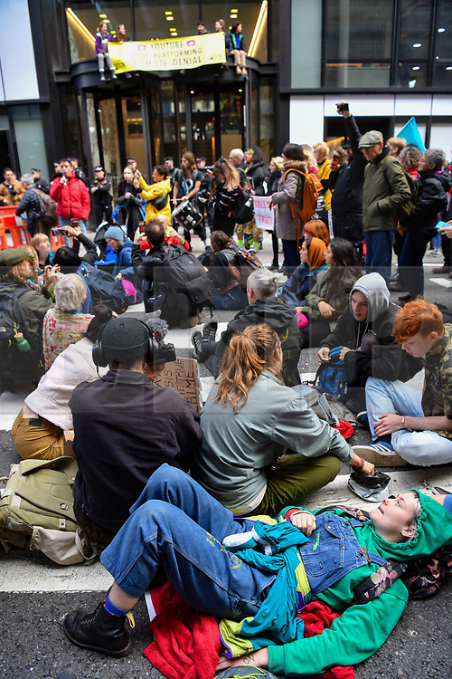 © Licensed to London News Pictures. 16/10/2019. London, UK. Young Extinction Rebellion activists (XR Youth) block the entrance to Google owned Youtube in Kings Cross London, calling for accurate representation on climate change on their platform. Photo credit: Guilhem Baker/LNP