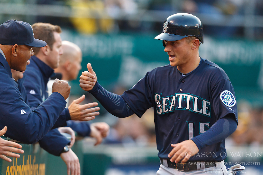 OAKLAND, CA - APRIL 07: Kyle Seager #15 of the Seattle Mariners is congratulated by teammates after scoring a run against the Oakland Athletics during the fourth inning at O.co Coliseum on April 7, 2012 in Oakland, California. The Seattle Mariners defeated the Oakland Athletics 8-7. (Photo by Jason O. Watson/Getty Images) *** Local Caption *** Kyle Seager