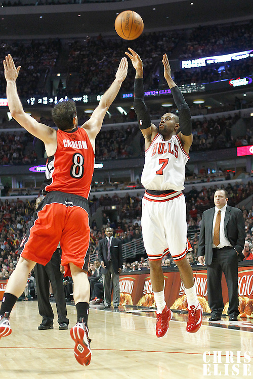 24 March 2012: Chicago Bulls point guard C.J. Watson (7) takes a jumpshot over Toronto Raptors point guard Jose Calderon (8) during the Chicago Bulls 102-101 victory in overtime over the Toronto Raptors at the United Center, Chicago, Illinois, USA.