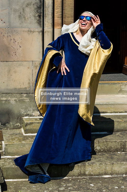 Pictured: The sun only shines on the rightious; Actress Katie Milne, dressed as St Margaret.<br /> <br /> Today Archbishop Leo Cushley was joined by 'St Margaret of Scotland' to unveil the publicity poster being sent to every Catholic parish in the country to advertise this summer's St Margaret's Pilgrimage, which will take place on 12 June in Dunfermline. Actress Katie Milne, dressed as St Margaret, joined the Archbishop in Edinburgh to launch the poster.<br /> <br /> Ger Harley   EEm 10 May April 2016