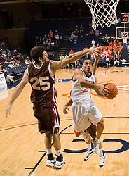 Virginia guard Mustapha Farrakhan (2) drives past Brown forward Peter Sullivan (25) for a layup.  The Virginia Cavaliers defeated the Brown University Bears 74-50 in NCAA Basketball at the John Paul Jones Arena on the Grounds of the University of Virginia in Charlottesville, VA on January 6, 2009.