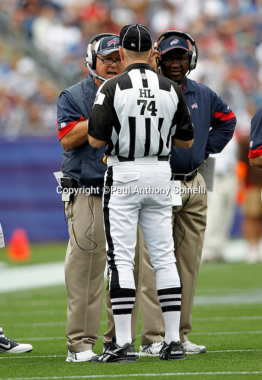 Buffalo Bills Head Coach Chan Gailey argues a call with NFL Head Linesman Derick Bowers (74) during the NFL regular season week 3 football game against the New England Patriots on September 26, 2010 in Foxborough, Massachusetts. The Patriots won the game 38-30. (©Paul Anthony Spinelli)