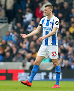 Brighton and Hove Albion defender Dan Burn (33) gestures during the The FA Cup 5th round match between Brighton and Hove Albion and Derby County at the American Express Community Stadium, Brighton and Hove, England on 16 February 2019.